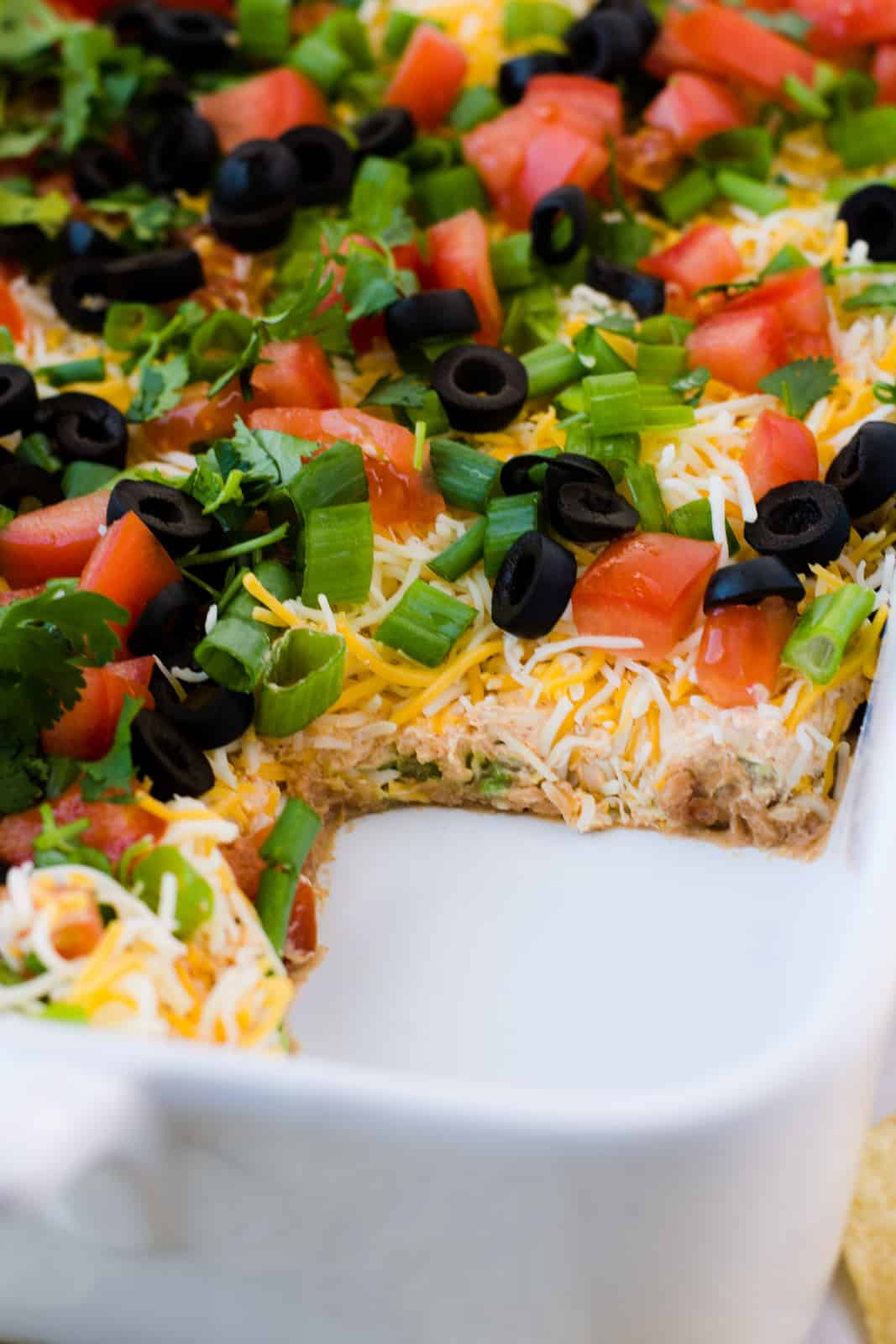 Square of 7 Layer Dip taken out of dish showing layers