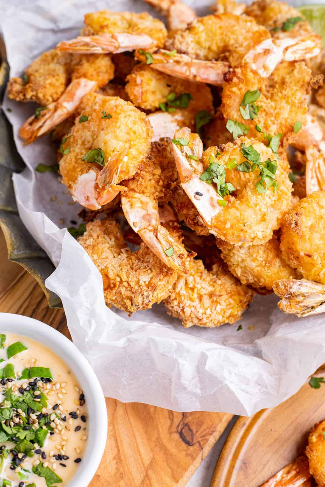 Overhead photo of shrimp in basket with dipping sauce on side