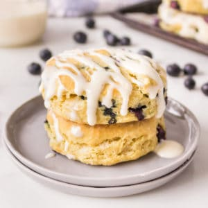 Square image of two stacked Blueberry Biscuit with glaze
