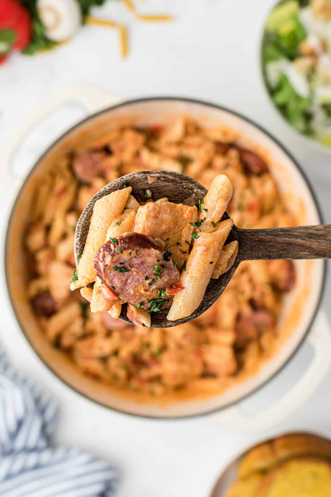 Wooden spoon holding up some Cajun Pasta