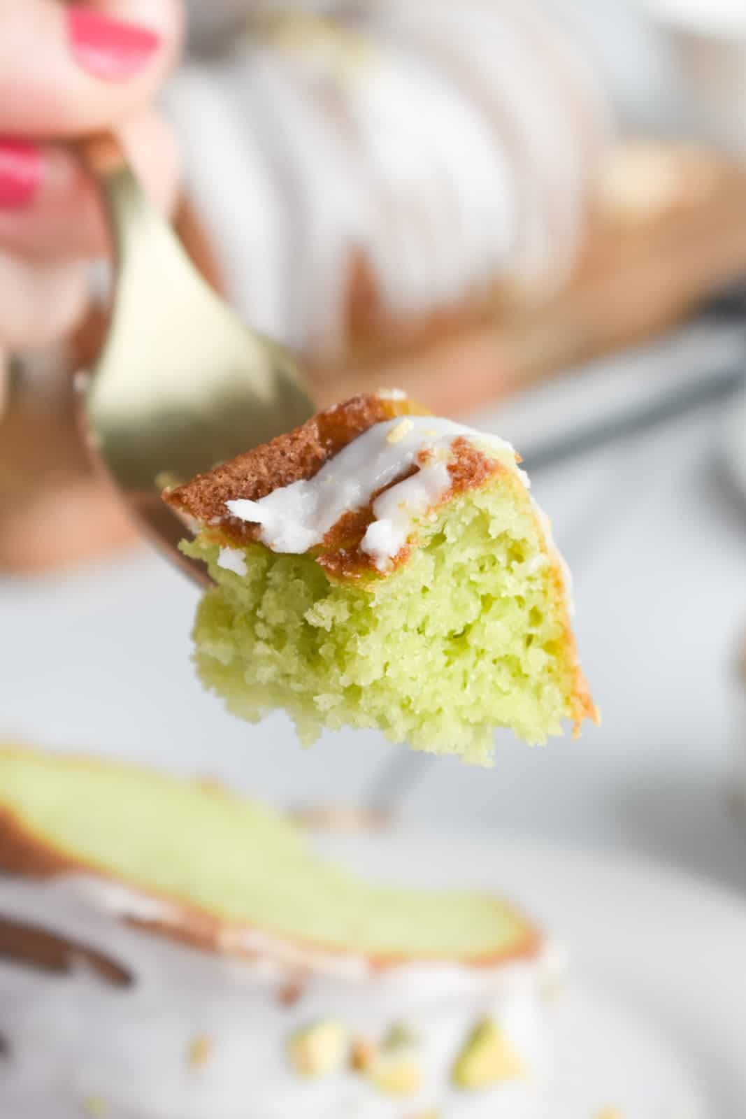 Fork holding up a bite out of the Pistachio Cake