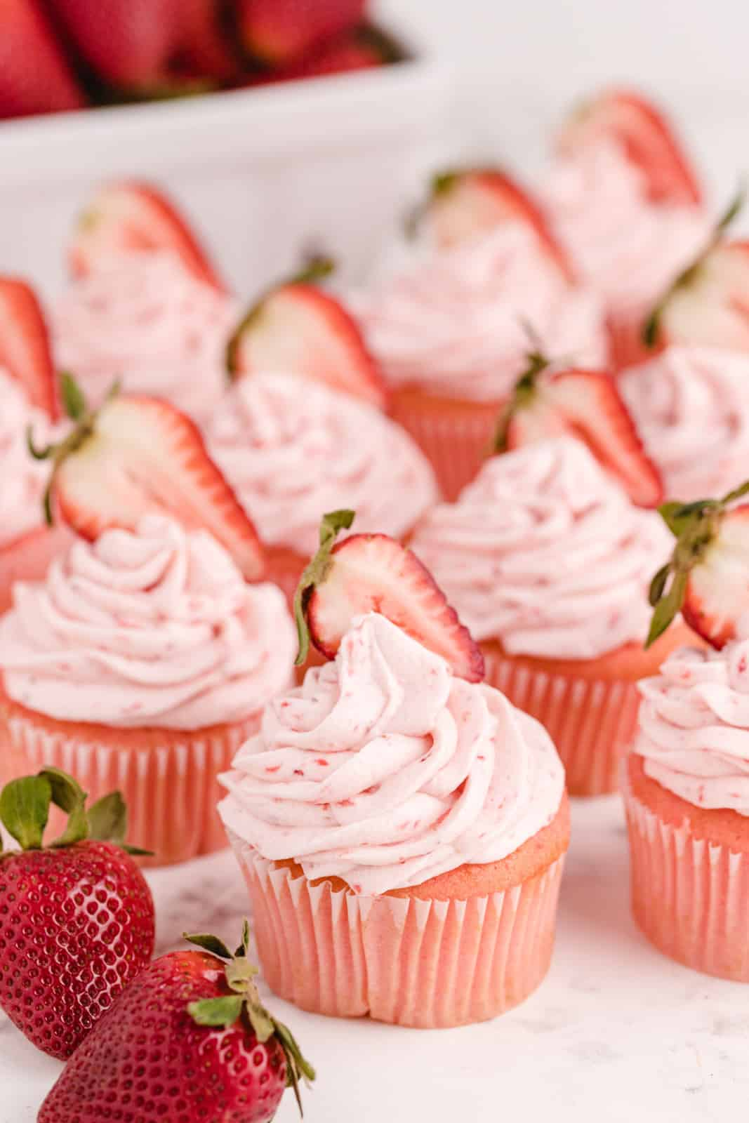 Strawberry Cupcakes on white board with strawberries