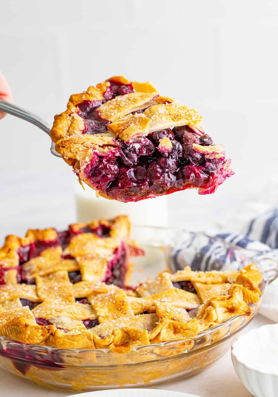 Pie scoop holding up slice of pie