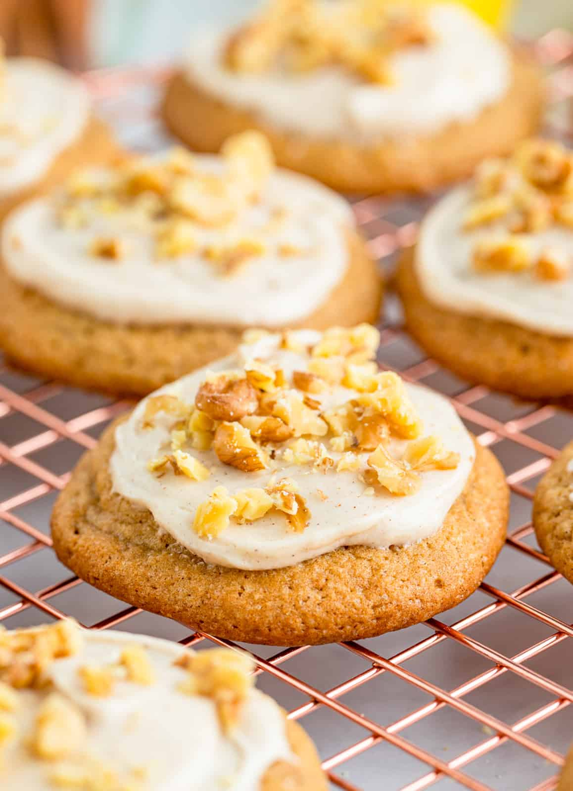 Banana Cookies on wire rack with frosting and nuts