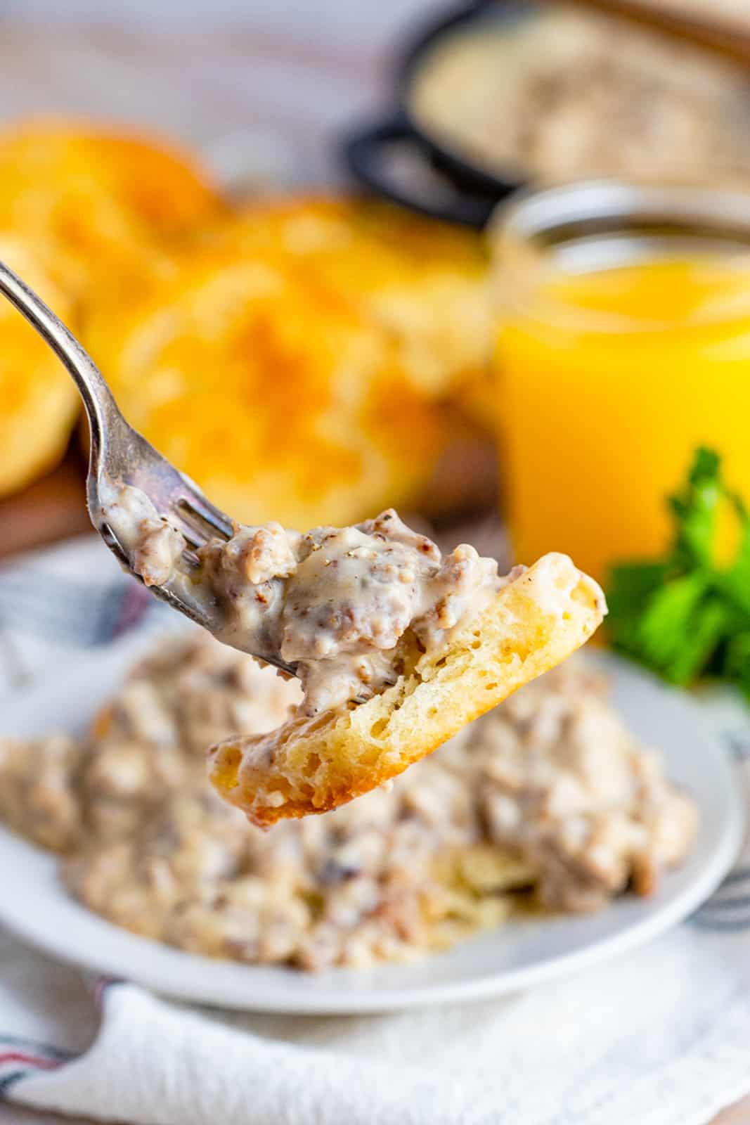 Fork holding a bite of the Biscuits and Gravy Recipe