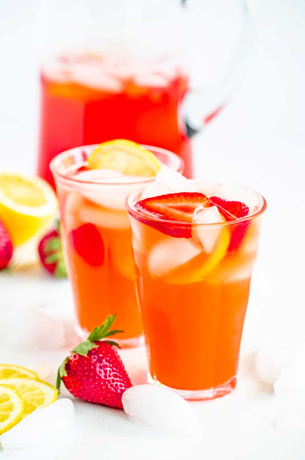Strawberry Lemonade Recipe in glasses with pitcher in background