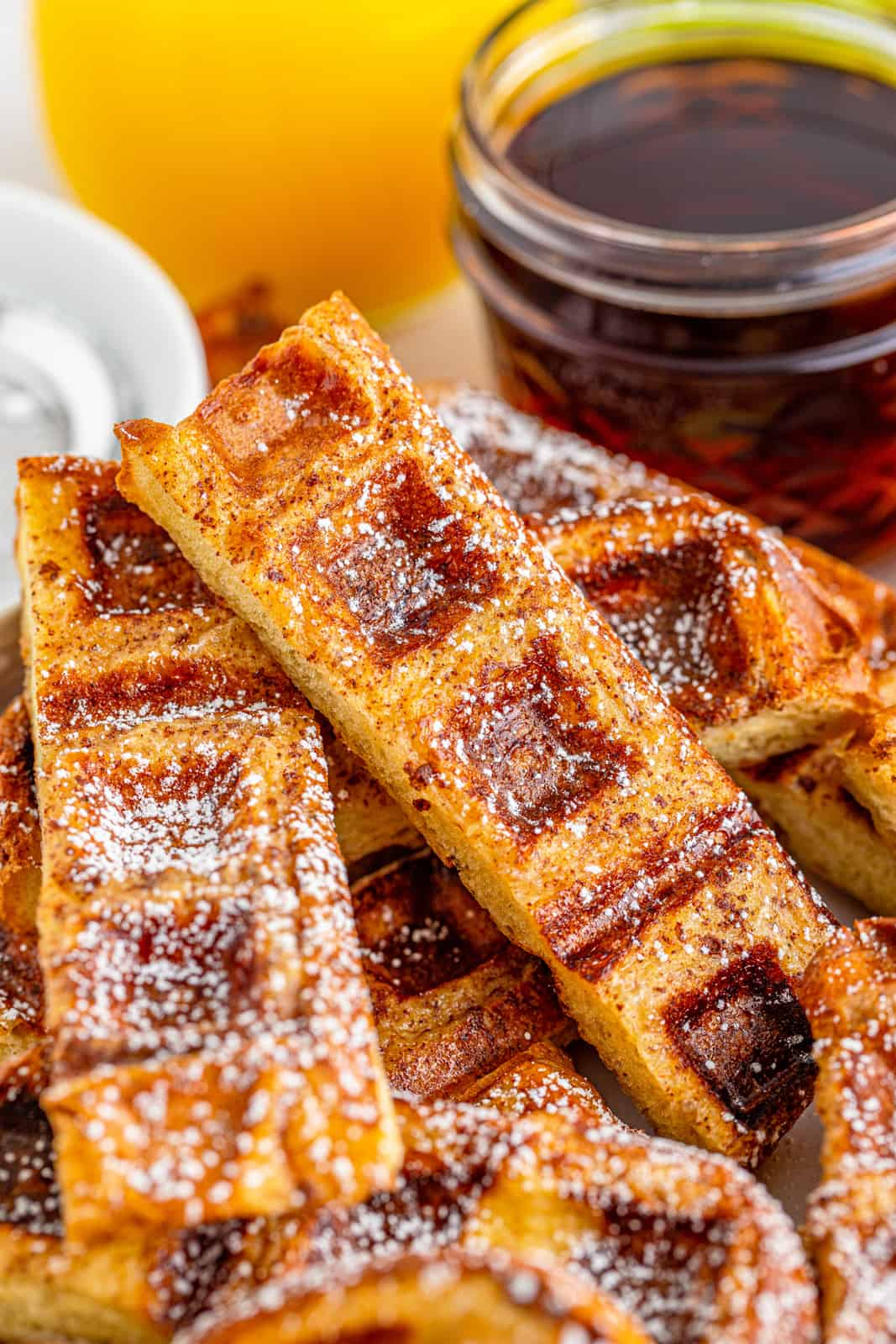 Close up on one Waffle Stick next to syrup.