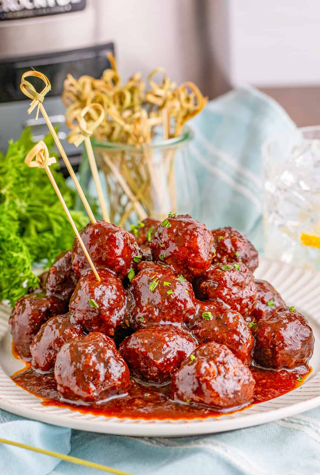 Grape Jelly Meatballs on plate showing sauce and parsley garnish.