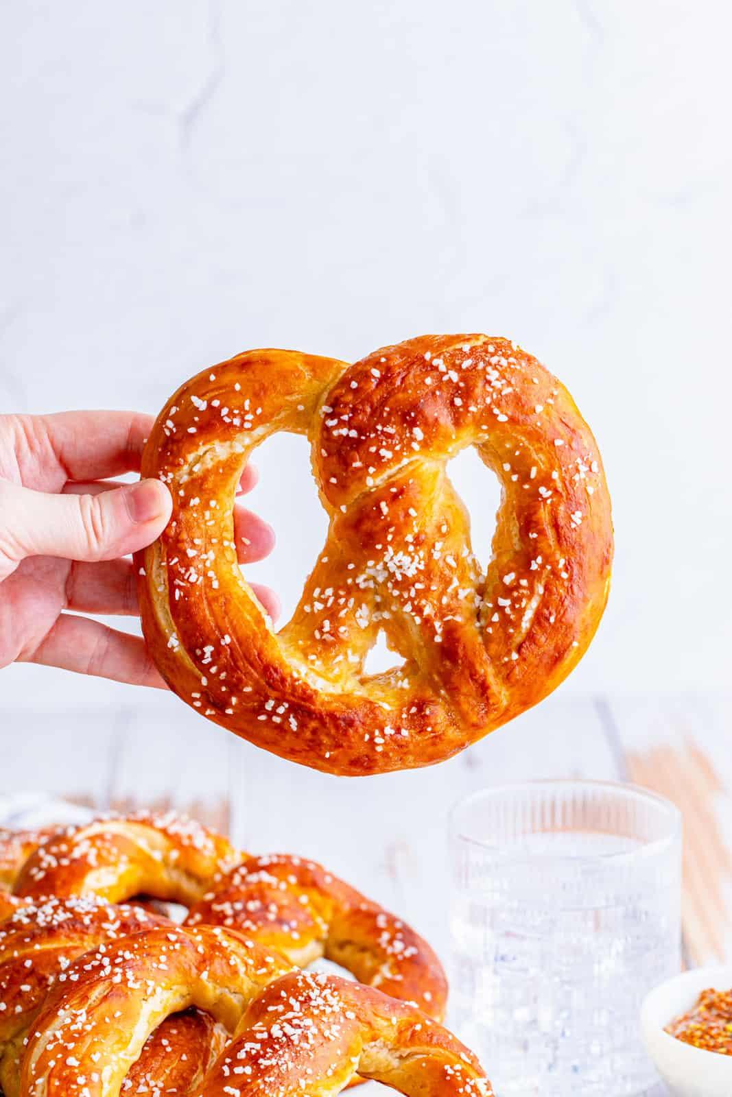 Hand holding up one pretzel