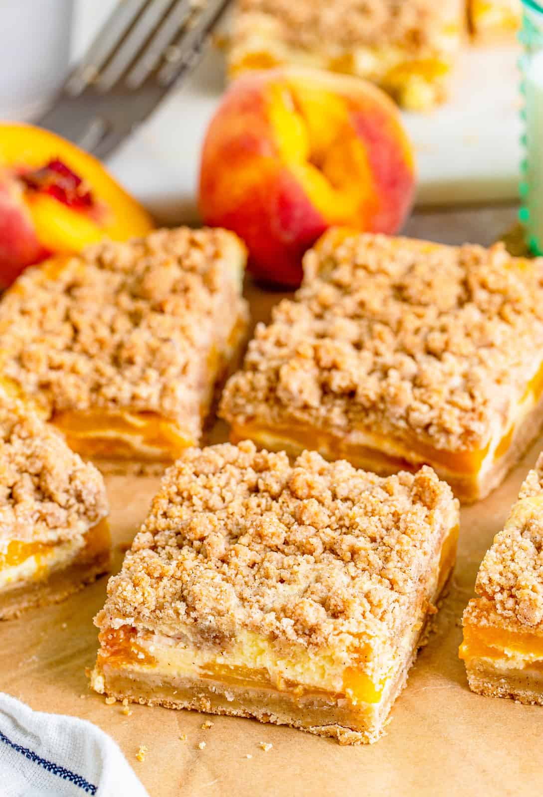 Cheesecake Bars sitting on brown parchment paper