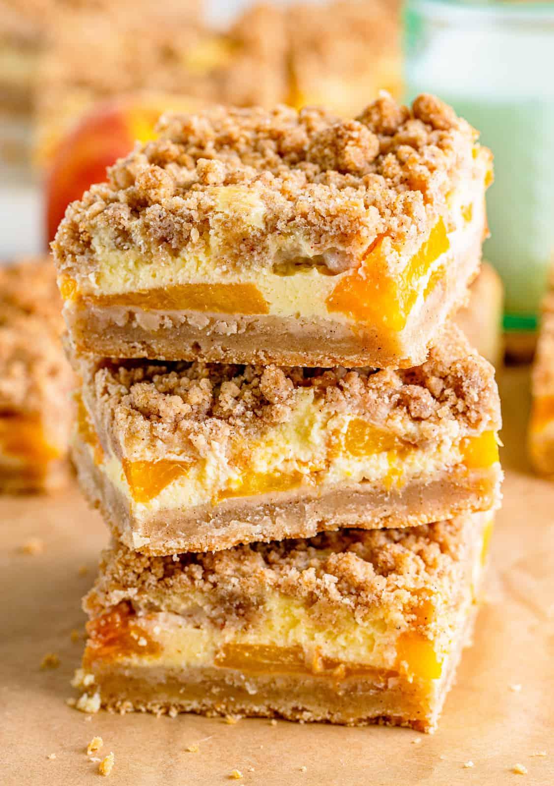 Three stacked Peach Cobbler Cheesecake Bars