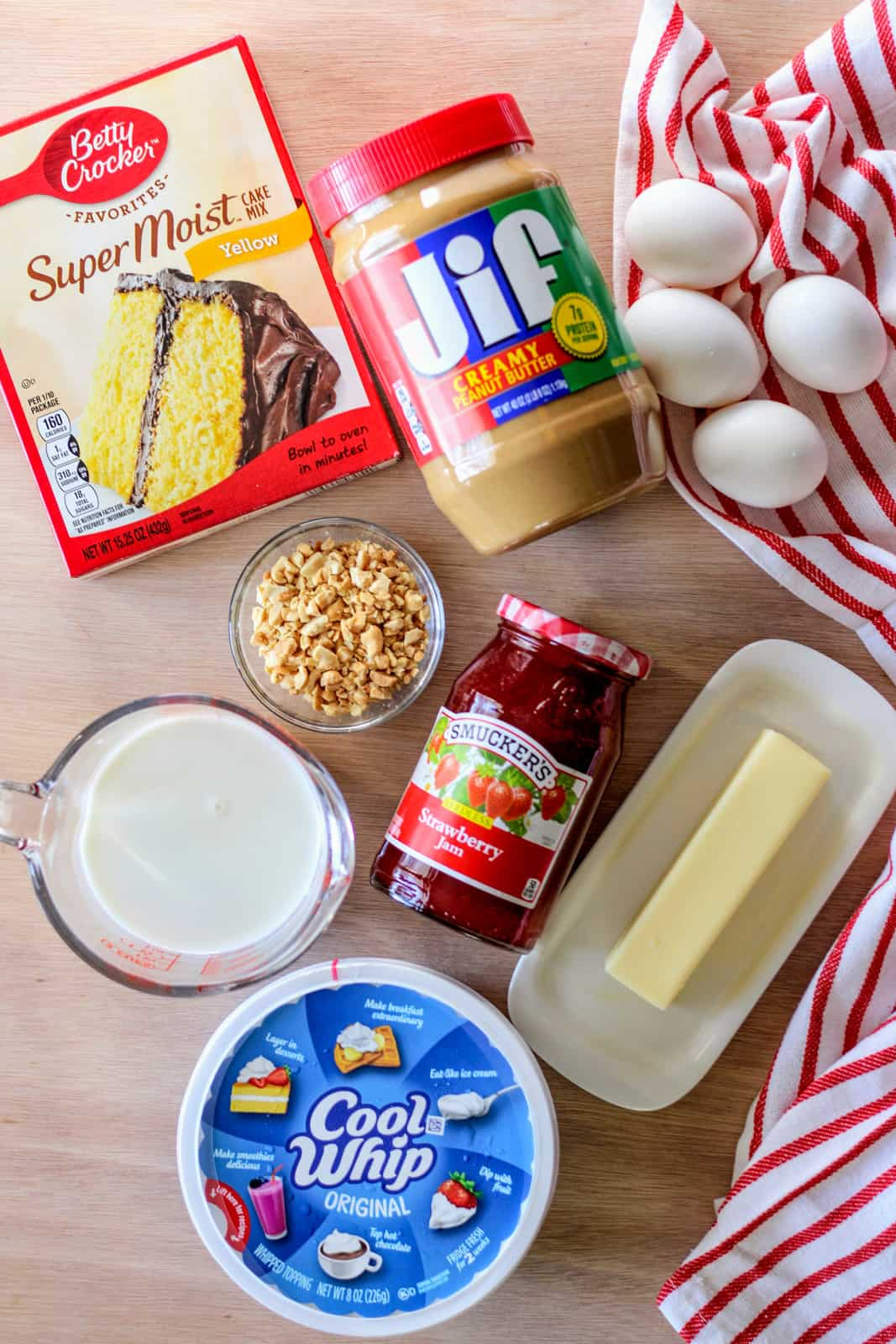 Ingredients needed to make a Peanut Butter and Jelly Poke Cake