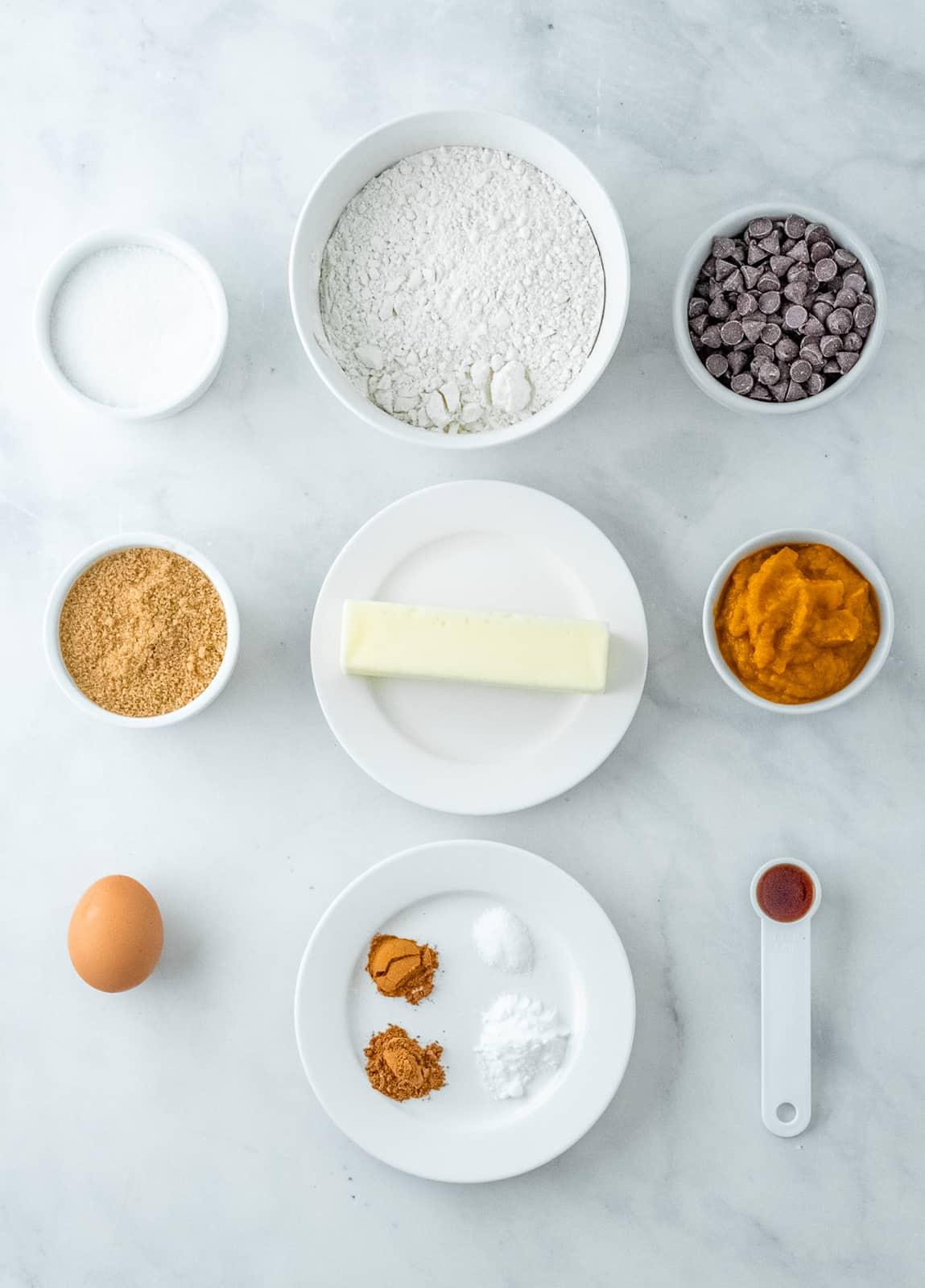 Ingredients needed to make Pumpkin Chocolate Chip Cookies.