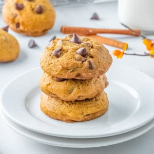 Square image of three stacked cookies on white plate