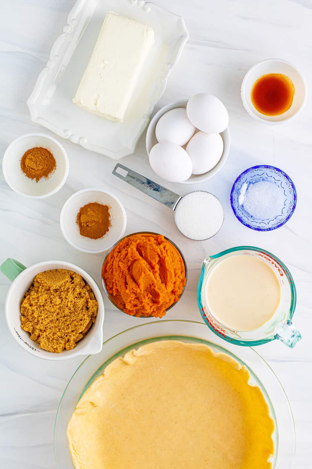 Ingredients needed to make a Pumpkin Cheesecake Pie.