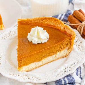 Square image of one slice of pie on white plate with a dollop of whipped cream.