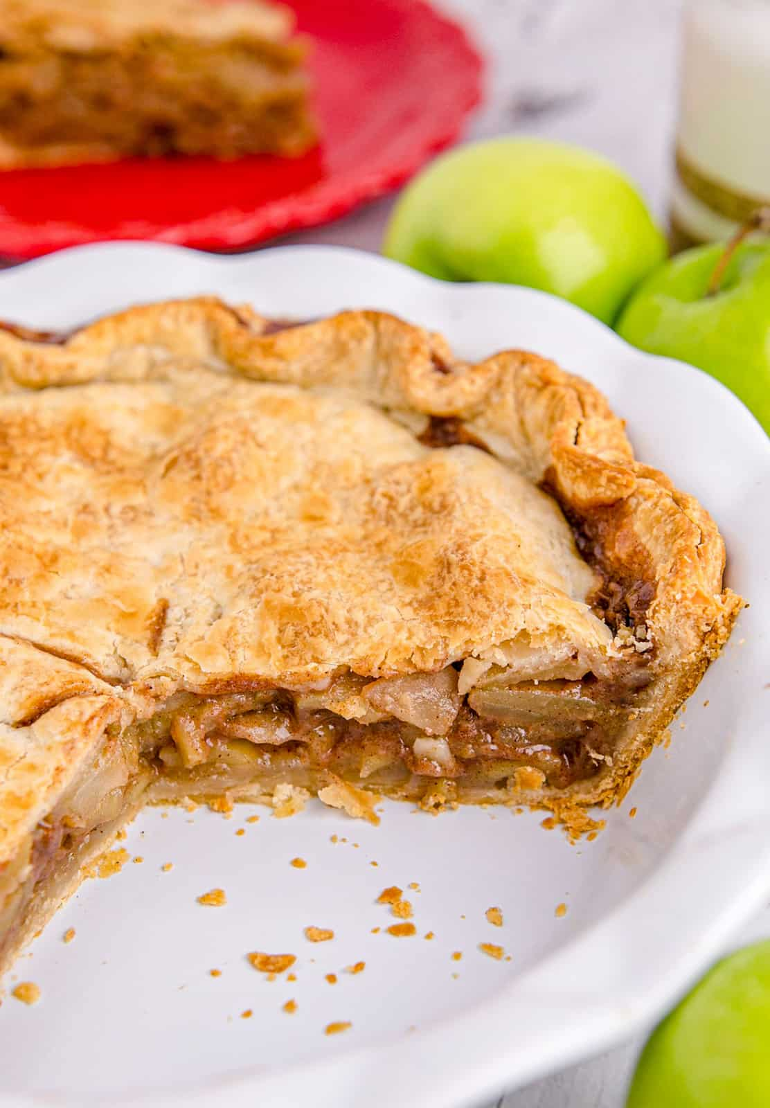 Slices of Apple Pie cut out of pie plate showing inside pie.
