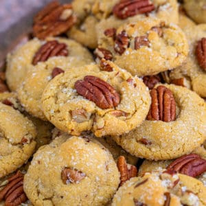 Square image of stacked cookies on hammered metal tray.