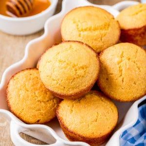 Squarre photo of Cornbread Muffins in white dish.