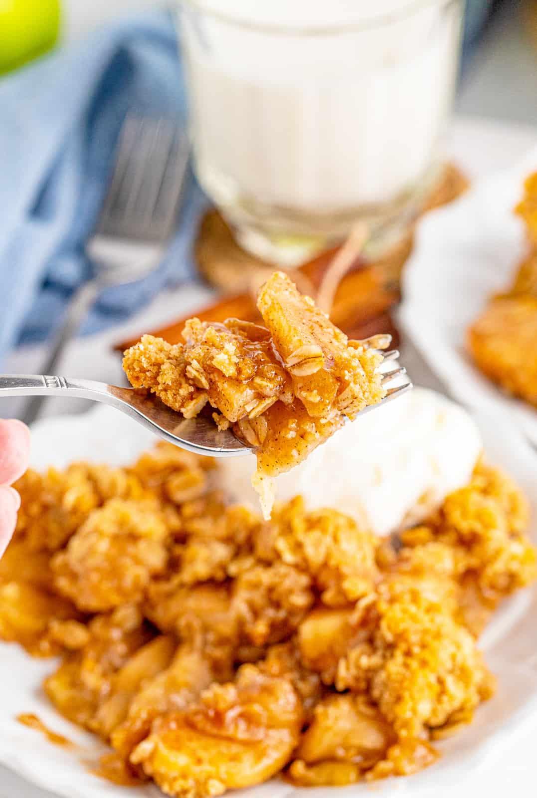 Fork full of a bite of crisp held up.