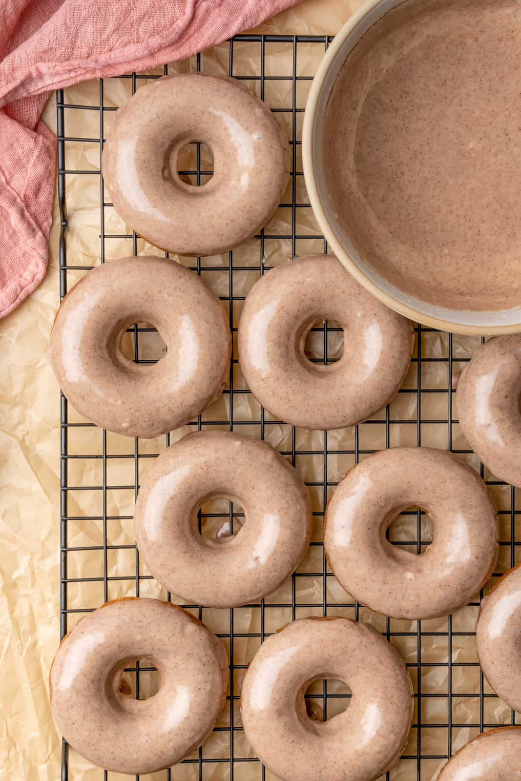 Overhead photo of Glazed Apple Cider Donuts on wire rack.