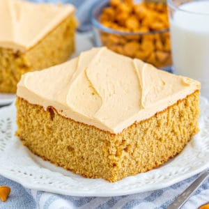 Square image of a slice of Butterscotch Cake on white plate.