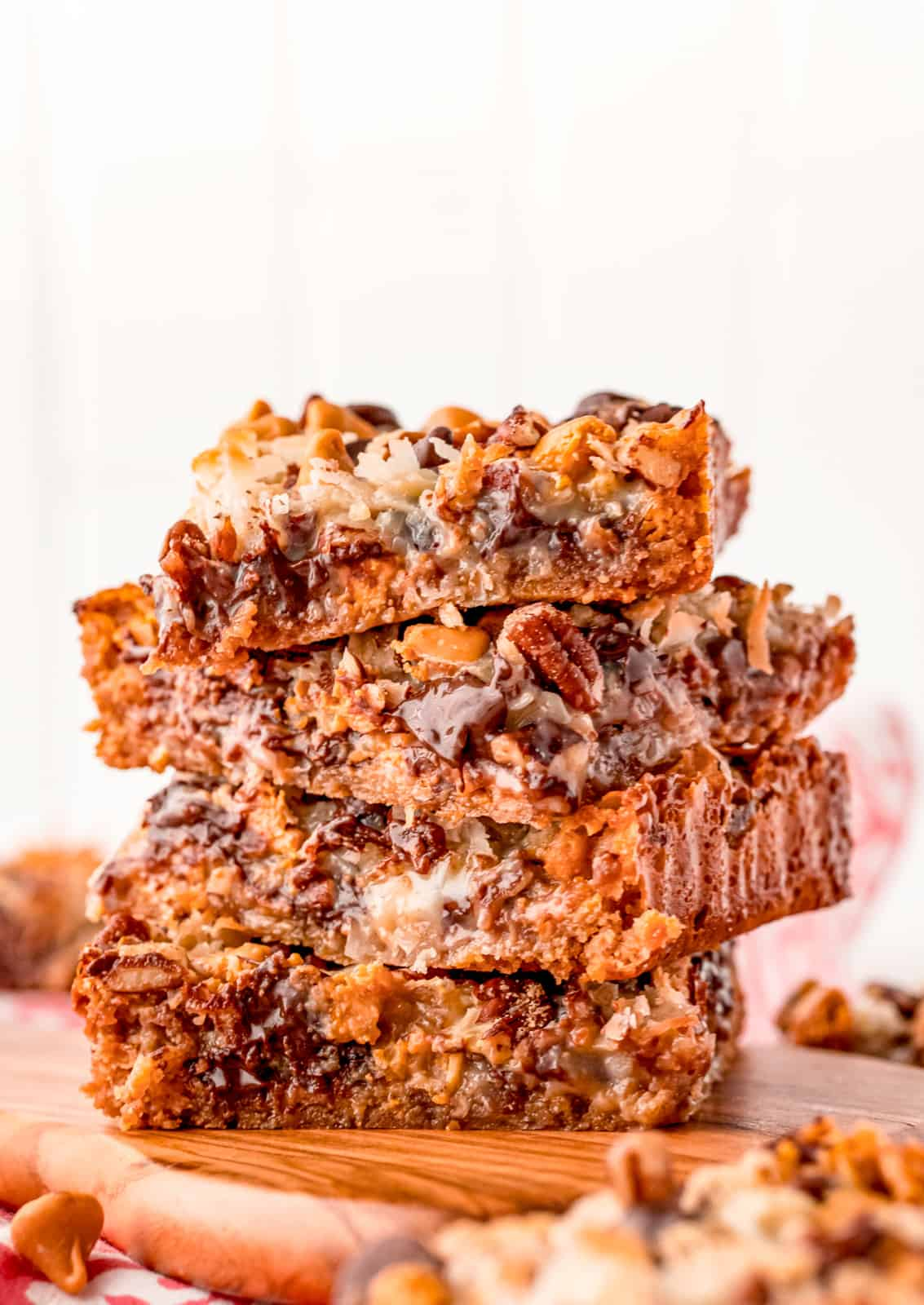 Four stacked Hello Dolly Bars showing gooey chocolate.