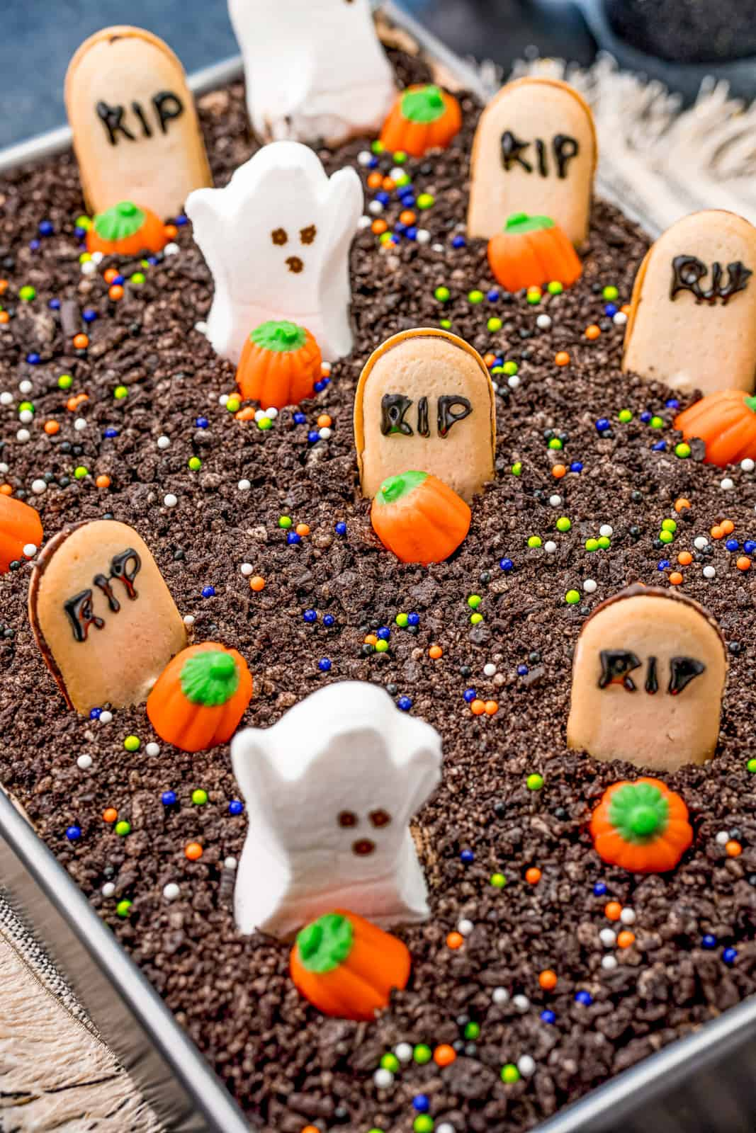 Finished Halloween Dirt Cake decorated in baking pan.