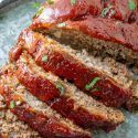 Sliced meatloaf on metal serving tray