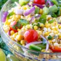Corn salad in bowl close up with vegetables